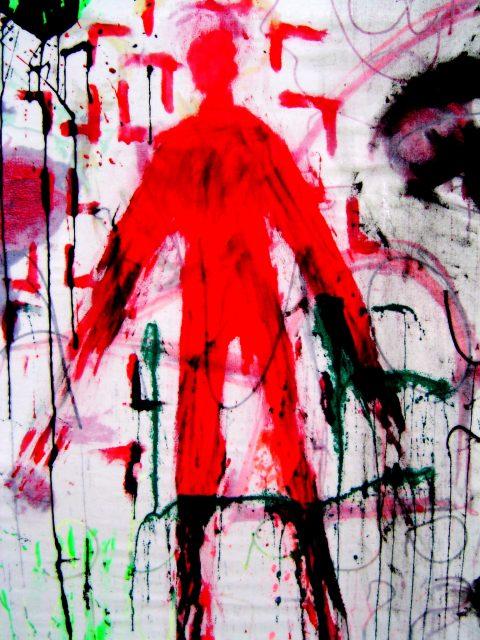 punainen hahmo maalattuna seinään
